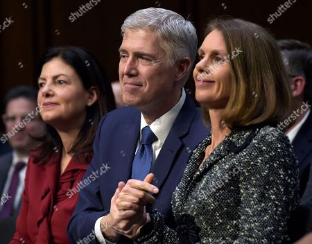Neil Gorsuch, Marie Louise Gorsuch, Kelly Ayotte Supreme Court Justice nominee Neil Gorsuch, center, hold the hands of his wife Marie Louise Gorsuch, right, as they listen to opening statements on Capitol Hill in Washington, during his confirmation hearing before the Senate Judiciary Committee. Former New Hampshire Senator Kelly Ayotte sits at left