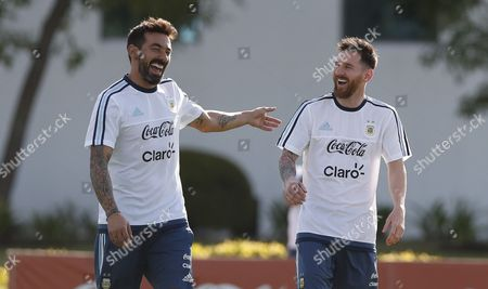 Stock Picture of Argentina's national soccer team players Ezequiel Lavezzi (L) and Lionel Messi participate in a training session at the Argentinian Soccer Association in Buenos Aires, Argentina, 21 March 2017. Argentina will face Chile 23 March for the FIFA 2018 Russia World Cup qualifying matches.