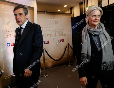 Conservative presidential candidate Francois Fillon, left, and his wife Penelope arrive for a television debate at French TV station TF1 in Aubervilliers, outside Paris, France, . The five leading candidates for France's presidential election are holding their first debate Monday, with centrist Emmanuel Macron and far-right leader Marine Le Pen leading polls and jobs and security among voters' top concerns