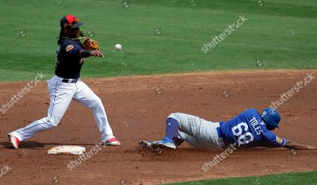 Los Angeles Dodgers' Andrew Toles (60) is forced out at second as Cleveland Indians' Michael Martinez throws to first to complete the double play on O'Koyea Dickson during the second inning of a spring training baseball game, in Goodyear, Ariz