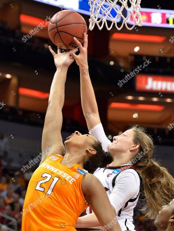 Mercedes Russell, Kylee Shook Tennessee's Mercedes Russell (21) and Louisville's Kylee Shook (21) reach a rebound during the first half of a second-round game in the NCAA women's college basketball tournament, in Louisville, Ky