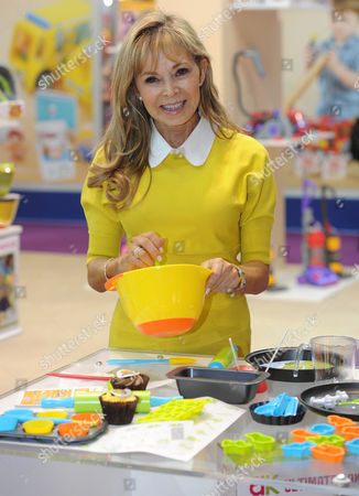 Annabel Karmel Poses With Her Cooking Set For Children The Set Is Designed To Work Properly But In Miniature. The Annual Toy Fair At Olympia In London Showcases A Number Of Different Toys Which Are Planning To Hit The Markets For The New Year.