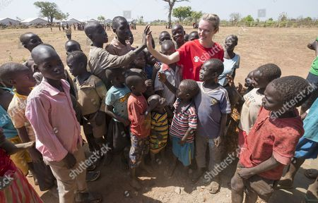 Save The Children's Gemma Parkin Pictured With Children From A School Run By The British Charity At The Nyumanzi Reception Centre In Northern Uganda. The Camp Holds More Than 4 000 Refugees From South Sudan. See David Williams Story.  7.2.16.
