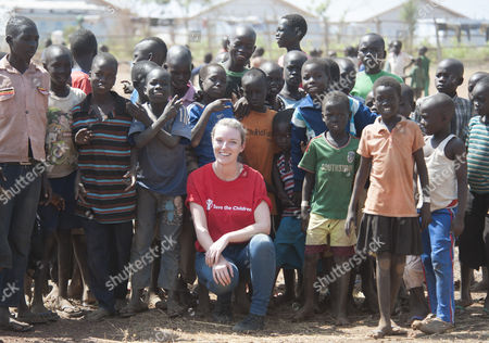 Stock Image of Save The Children's Gemma Parkin Pictured With Children From A School Run By The British Charity At The Nyumanzi Reception Centre In Northern Uganda. The Camp Holds More Than 4 000 Refugees From South Sudan. See David Williams Story.  7.2.16.