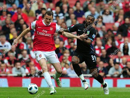Sebastien Squillaci of Arsenal and Darren Bent of Aston Villa United Kingdom London