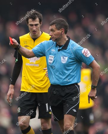 Referee Andre Marriner Shows Gael Givet (not Pictured) A Red Card For His Tackled On Robin Van Persie of Arsenal United Kingdom London