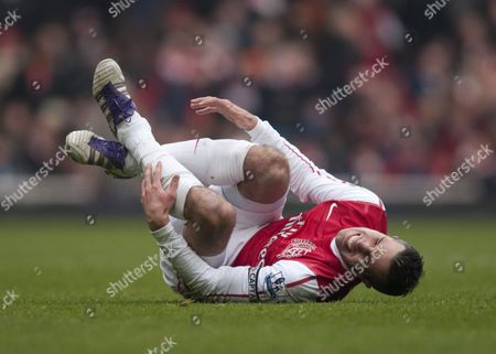 Robin Van Persie of Arsenal Winces in Pain After Being Tacked by Gael Givet of Blackburn Rovers United Kingdom London