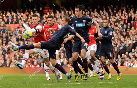 Morten Gamst Pedersen of Blackburn Rovers Clears the Ball United Kingdom London