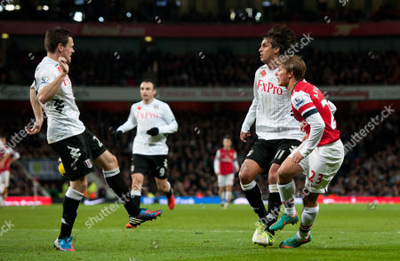 Andrey Arshavin of Arsenal Crosses the Ball Into the Arm of Sascha Riether of Fulham For A Penalty United Kingdom London