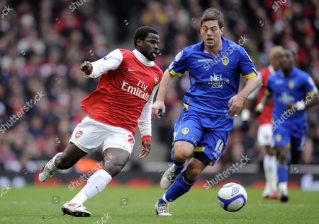 Emmanuel Eboue of Arsenal and Ben Parker of Leeds United United Kingdom London