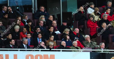 Arsenal Majority Shareholder Stan Kroenke Top Row Second Left Moves Seats For the Second Half Chairman Peter Hill Wood Front Row Far Right and Chief Executive Ivan Gazidis 2nd Top Row 3rd Right All Look On United Kingdom London