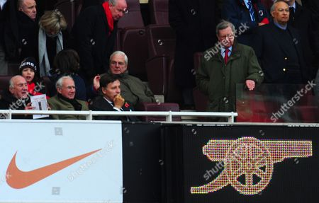 Arsenal Majority Shareholder Stan Kroenke in His Seat As Chairman Peter Hill Wood Walks Down to Occupy His Seat Kroenke Was not in His Seat For the Second Half United Kingdom London