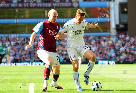 James Collins of Aston Villa and Peter Lovenkrands of Newcastle United United Kingdom Birmingham
