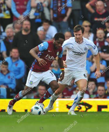 Stock Photo of Jean Ii Makoun of Aston Villa and Mike Williamson of Newcastle United United Kingdom Birmingham