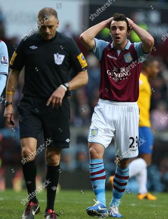 Enda Stevens of Aston Villa Shows A Look of Dejection As Referee Mark Halsey Awards A Penalty to Southampton United Kingdom Birmingham