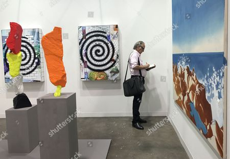 Stock Photo of A visitor takes notes on an untitled artwork' by Polish artist Wilhelm Sasnal, Hong Kong, China, 21 March 2017. The fifth Art Basel in Hong Kong runs from 23 to 24 March 2017, and hosts about 242 galleries from 34 countries and regions around the world.