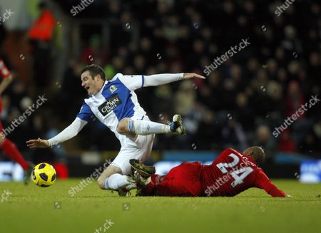 David N'gog of Liverpool and Ryan Nelsen of Blackburn Rovers United Kingdom Blackburn