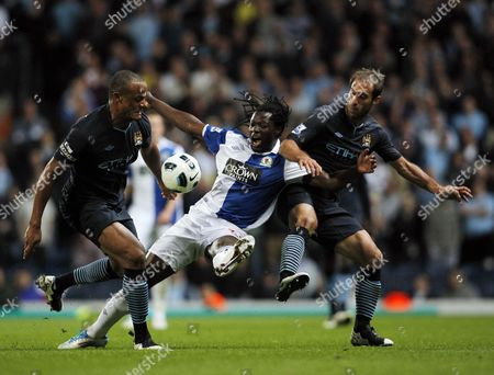 Benjani Mwaruwari of Blackburn Rovers in Between Pablo Zabaleta and Vincent Kompany of Manchester City United Kingdom Blackburn