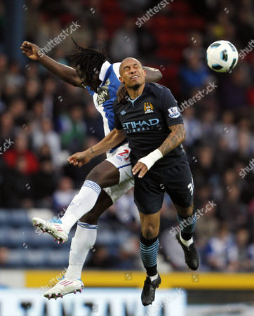 Benjani Mwaruwari of Blackburn Rovers and Nigel De Jong of Manchester City United Kingdom Blackburn