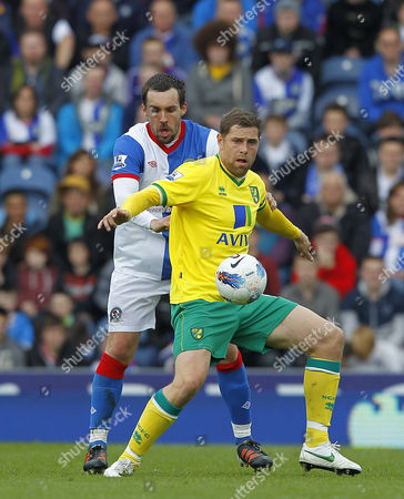 Gael Givet of Blackburn Rovers Returning to the Starting Line Up in Action with Grant Holt of Norwich City United Kingdom Blackburn