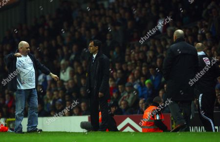 A Blackburn Rovers Fan Appears to Throw Something at Manager Steve Kean During the Game United Kingdom Blackburn