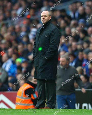 Blackburn Rovers Manager Steve Kean Looks On with A Lazer Light Aimed at Him United Kingdom Blackburn