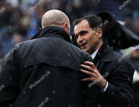Wigan Athletic Manager Roberto Martinez Winks at Counterpart Steve Kean of Blackburn Rovers Before the Game United Kingdom Blackburn