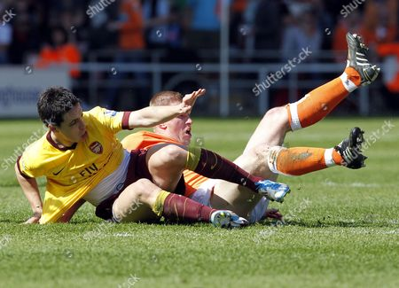 Samir Nasri of Arsenal Slides Into Keith Southern of Blackpool United Kingdom Blackpool