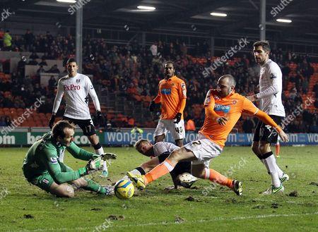 Fulham Goalkeeper Mark Schwarzer Makes A Save From Gary Taylor-fletcher of Blackpool United Kingdom Blackpool
