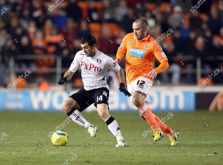 Giorgos Karagounis of Fulham and Gary Taylor-fletcher of Blackpool United Kingdom Blackpool