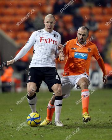Philippe Senderos of Fulham and Gary Taylor-fletcher of Blackpool United Kingdom Blackpool