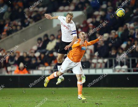 Brede Hangeland of Fulham and Gary Taylor-fletcher of Blackpool United Kingdom Blackpool