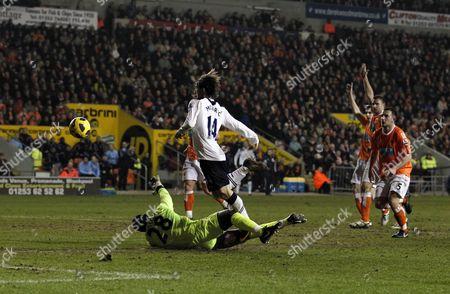 Blackpool Goalkeeper Richard Kingson Puts Pressure On Luka Modric of Tottenham Hotspur Who Fails to Score United Kingdom Blackpool