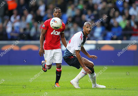 David N'gog of Bolton Wanderers in Action with Patrice Evra of Manchester United United Kingdom Bolton