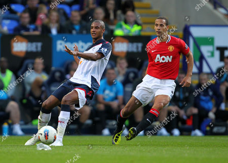 Rio Ferdinand of Manchester United in Action with David N'gog of Bolton Wanderers United Kingdom Bolton