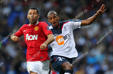 Ryan Giggs of Manchester United in Action with David N'gog of Bolton Wanderers United Kingdom Bolton
