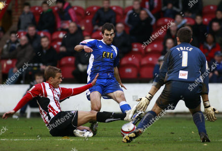 Danny Foster of Brentford Block A Shot From Danny Schofield of Millwall United Kingdom London