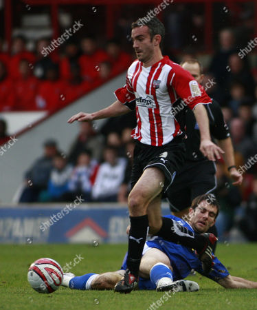 Kevin O'connor of Brentford with Danny Schofield of Millwall United Kingdom London