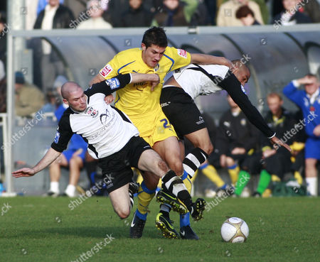 Stock Image of Danny Batth of Colchester United Battles with Mark Corneille and Ashley Carew of Bromley