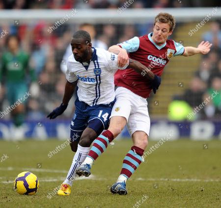 Wade Elliott of Burnley and Quincy Owusu-abeyie of Portsmouth United Kingdom Burnley
