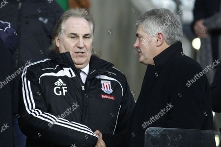 Stoke City First Team Coach Gerry Francis and Supporter Nick Hancock Greet Each Other in the Stands United Kingdom Cardiff