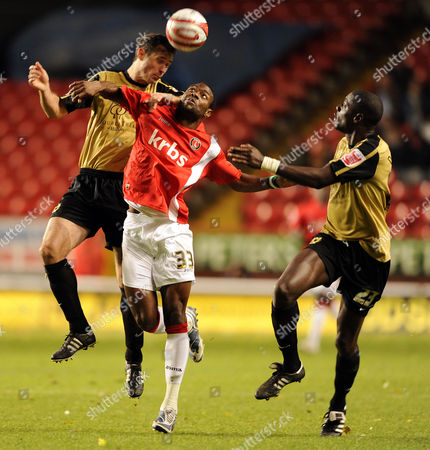 Akpo Sodje of Charlton Athletic and Darren Powell and Peter Leven of Mk Dons United Kingdom London
