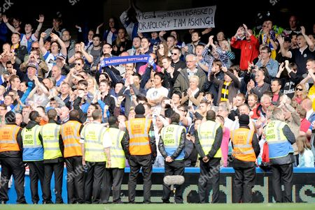 Blackburn Rovers Fans Are Guarded by Stewards While the Hold Up Anti- Blackburn Rovers Manager Steve Kean Signs United Kingdom London