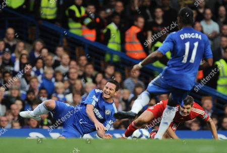 Steven Gerrard of Liverpool Was Booked by Referee Martin Atkinson For This Foul On Frank Lampard of Chelsea United Kingdom London