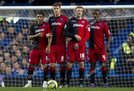 Portsmouth Players Hayden Mullins Marko Futacs Dave Kitson and Aaron Mokoena Line Up A Wall to Defend A Chelsea Free Kick United Kingdom London