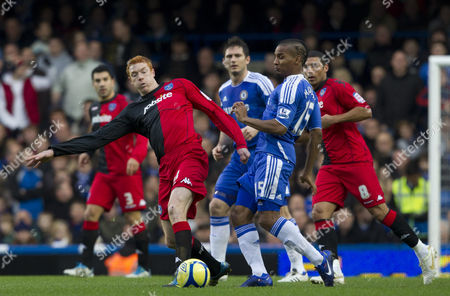 Dave Kitson of Portsmouth and Florent Malouda of Chelsea in Action United Kingdom London
