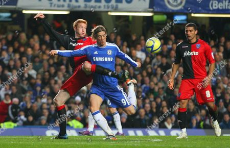 Dave Kitson of Portsmouth Tackles Fernando Torres of Chelsea As He Prepares to Shoot United Kingdom London