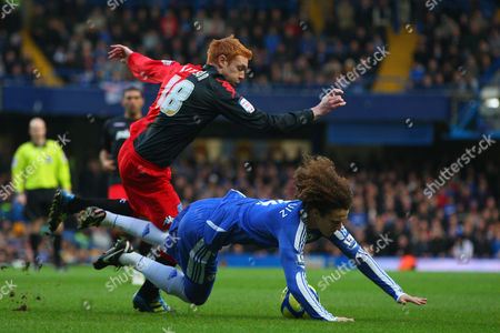 Dave Kitson of Portsmouth Fouls David Luiz of Chelsea United Kingdom London