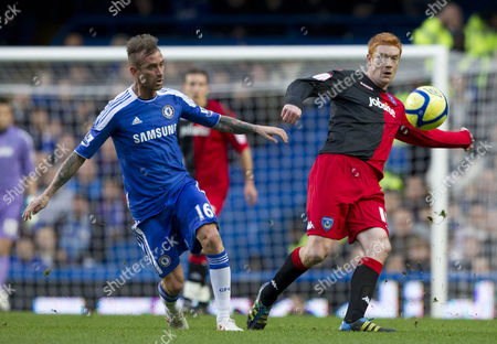 Raul Meireles of Chelsea and Dave Kitson of Portsmouth in Action United Kingdom London