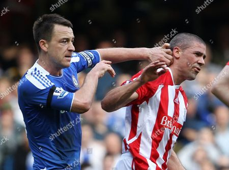 John Terry of Chelsea Clashes with Jonathan Walters of Stoke City United Kingdom London